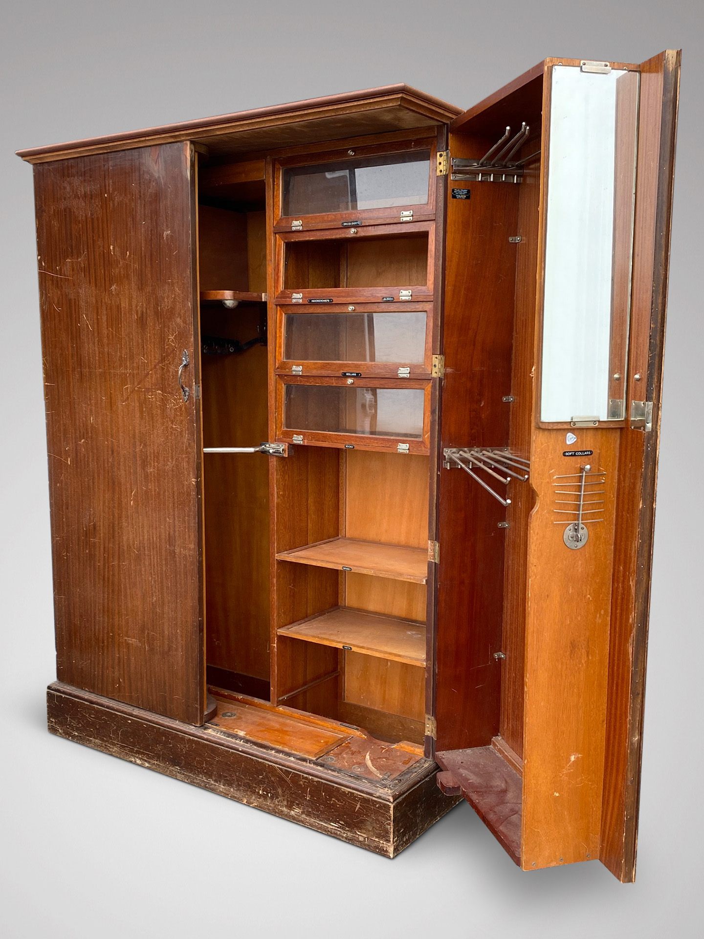A COMPACTUM GENTLEMANS FITTED WARDROBE