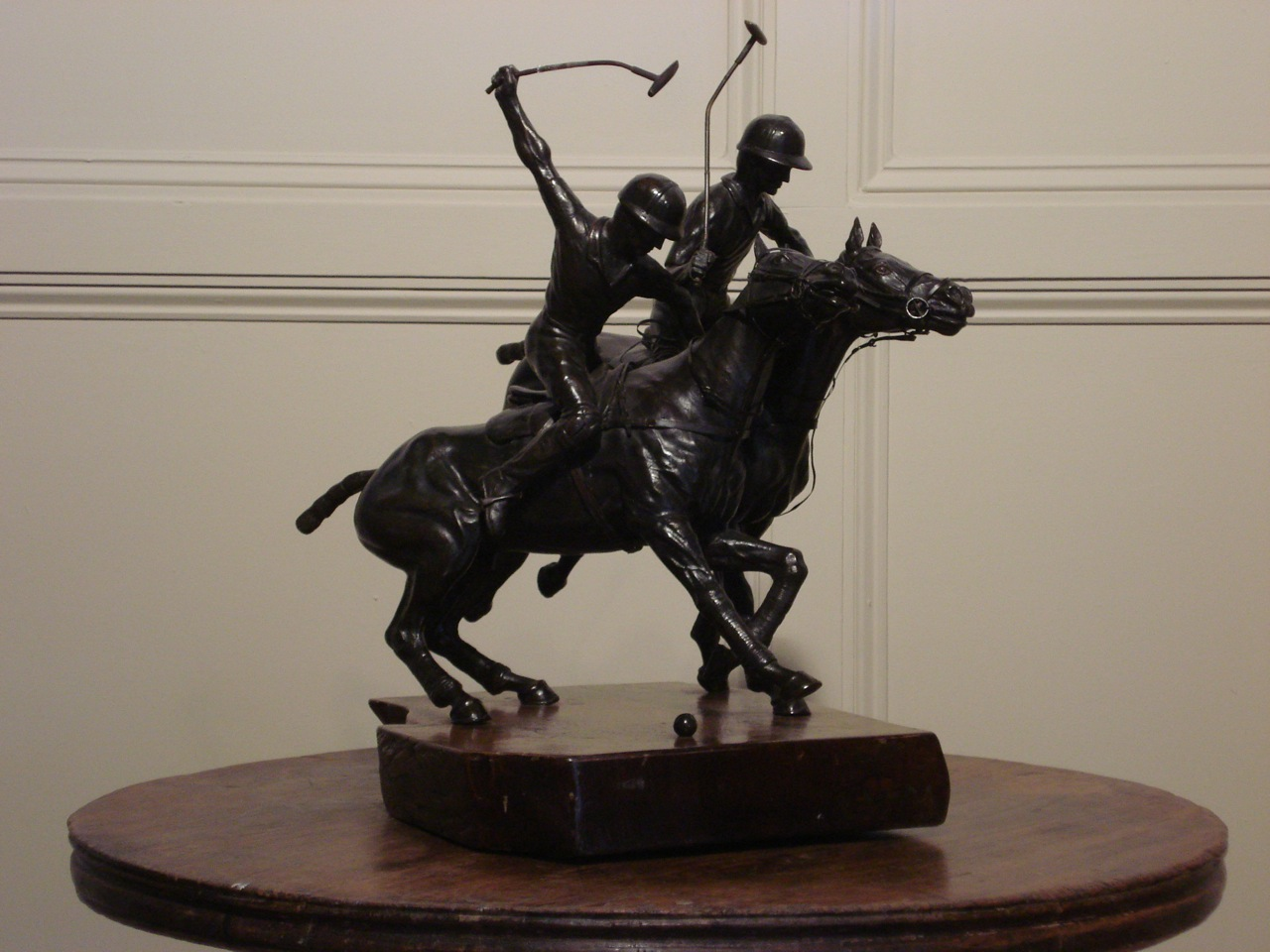 SOLD/20TH C. BRONZE EQUESTRIAN FIGURE GROUP, MODELLED AS TWO POLO PLAY