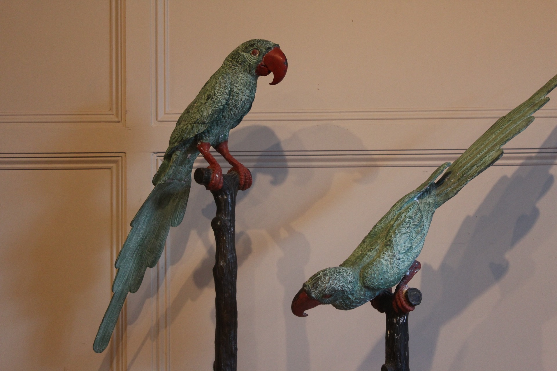 SOLD/PAIR OF PAINTED CAST METAL FIGURES OF PARROTS