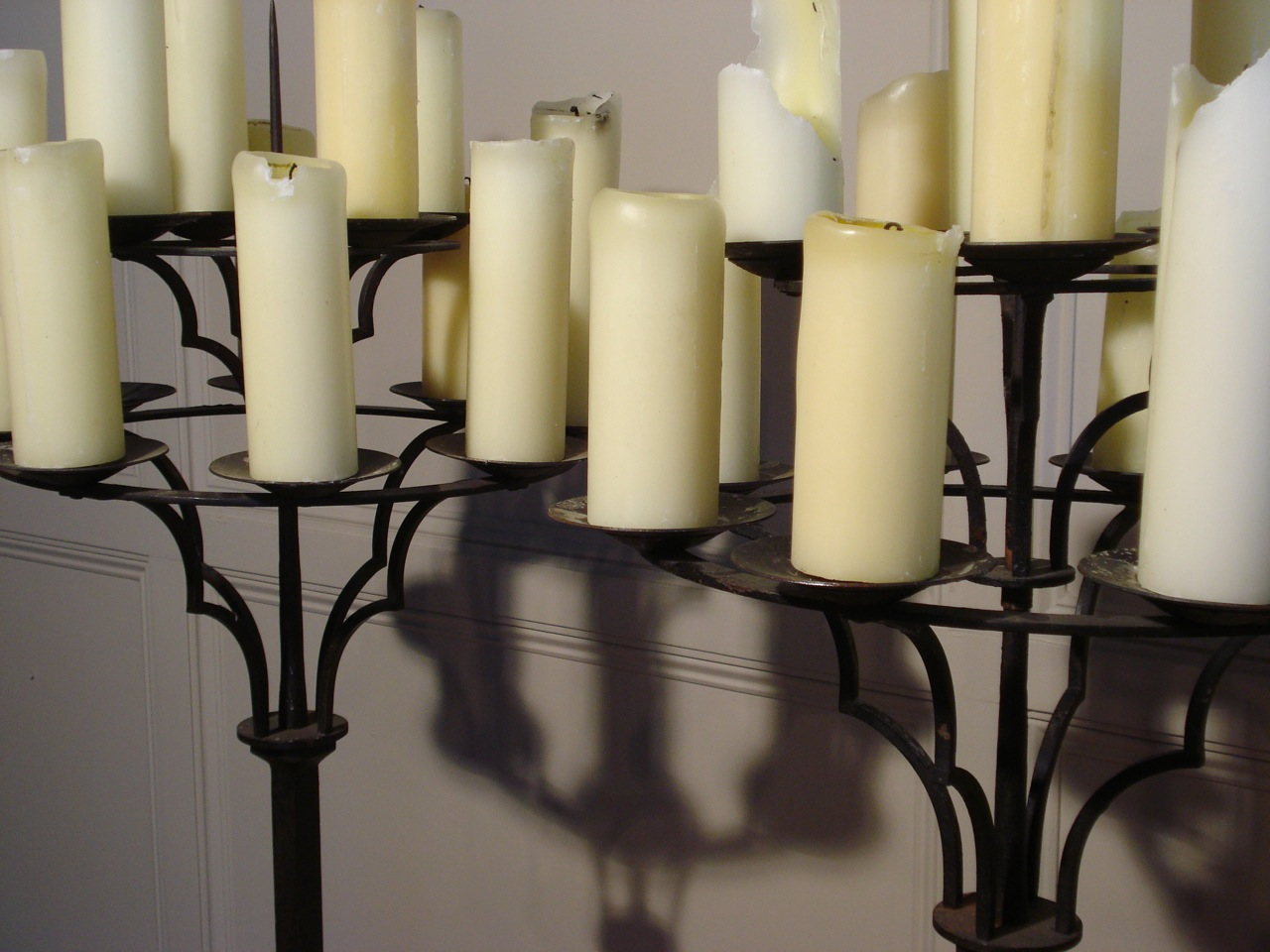 SOLD/PAIR OF WROUGHT IRON TWELVE BRANCH ALTAR CANDELABRA